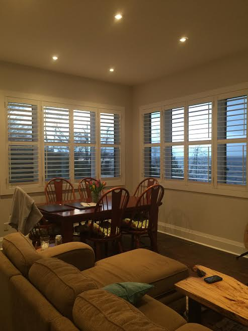 dad and son talk about cost of plantation shutters